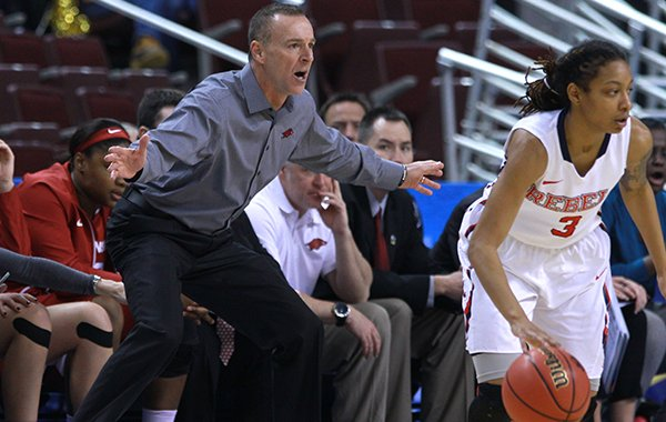 Arkansas coach Jimmy Dykes motions from the sideline during a game against Ole Miss on Thursday, March 5, 2015, during the SEC Tournament at Verizon Arena in North Little Rock.
