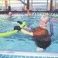 Janet Humphrey teaches an aqua aerobics class Friday at The Jones Center in Springdale. The center r...