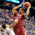 University of Arkansas guard Anton Beard drives to the hoop past Kentucky defender Tyler Ulis during...