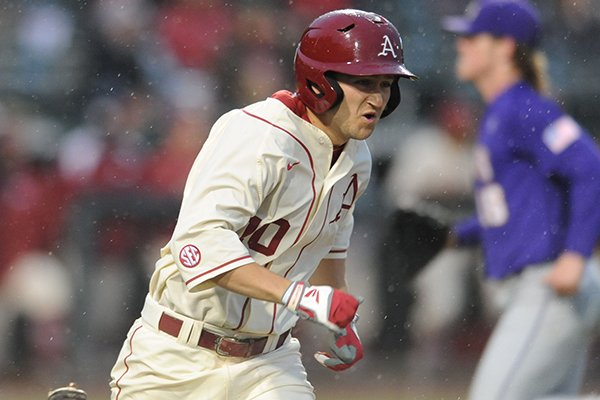 Arkansas outfielder Joe Serrano runs to first base after an RBI single during a game against LSU on Thursday, March 19, 2015, at Baum Stadium in Fayetteville.