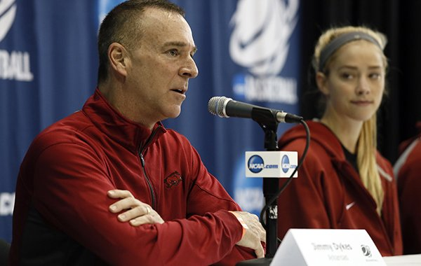 Arkansas head coach Jimmy Dykes responds to a question as Calli Berna, right, watches during a news conference for the first round of the NCAA women's college basketball tournament Thursday, March 19, 2015, in Waco, Texas. Arkansas plays Northwestern on Friday. (AP Photo/Tony Gutierrez)
