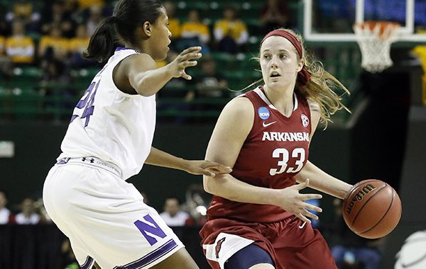 Northwestern's Christen Inman (24) defends as Arkansas' Melissa Wolff (33) moves the ball around the perimeter in the first half of a women's college basketball game in the first round of the NCAA tournament, Friday, March 20, 2015, in Waco, Texas. (AP Photo/Tony Gutierrez)
