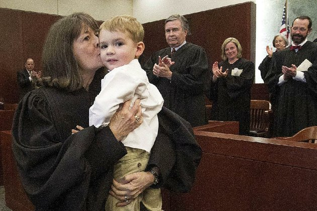 arkansas-democrat-gazettebenjamin-krain-32015-phyllis-jones-and-her-grandson-tucker-moore-are-applauded-by-federal-judges-after-being-robed-as-a-new-united-states-bankruptcy-judge-during-an-investiture-ceremony-at-the-federal-courthouse-in-little-rock-on-friday