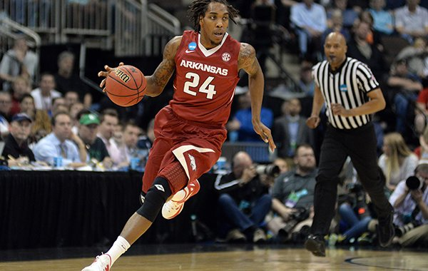Arkansas guard Michael Qualls (24) drives up the court against North Carolina during the first half of an NCAA tournament third round basketball game Saturday, March 21, 2015, in Jacksonville, Fla. (AP Photo/Rick Wilson)