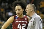 Arkansas' Jhasmin Bowen (42) talks with head coach Jimmy Dykes, right, late in the second half of a women's college basketball game against Baylor in the second round of the NCAA tournament Sunday, March 22, 2015, in Waco, Texas. Baylor won 73-44. (AP Photo/Tony Gutierrez)