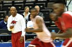 Arkansas coach Mike Anderson watches practice Wednesday, March 18, 2015, at Veterans Memorial Arena in Jacksonville, Fla.