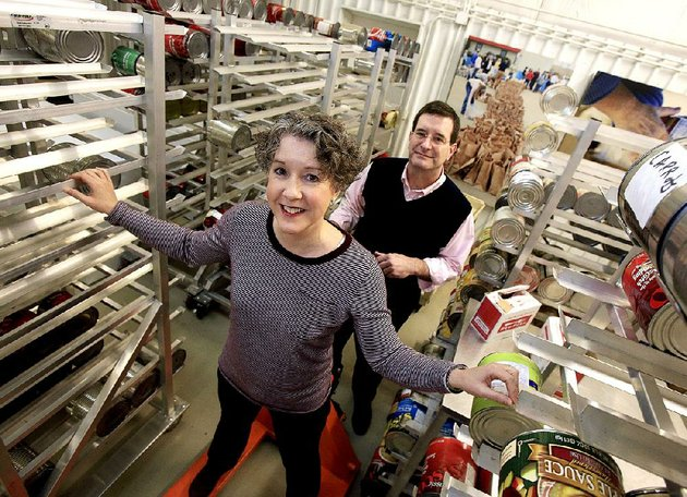 dr-laura-lamps-and-husband-paul-ward-kid-around-in-the-storage-area-of-potluck-food-rescue-for-arkansas-in-north-little-rock-they-are-co-chairmen-for-not-at-all-a-ball-potlucks-non-event-fundraiser