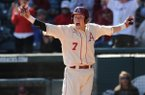 Bobby Wernes of Arkansas celebrates scoring from third while the Mississippi battery were not paying attention during the fifth inning Saturday, March 28, 2015, at Baum Stadium in Fayetteville.