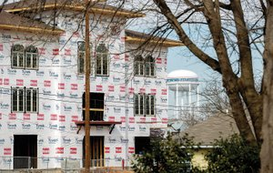 NWA Democrat-Gazette/JASON IVESTER — Construction continues Feb. 25 on the 210 Towers condominiums in downtown Bentonville. Vibrant downtowns are one way to attract the most sought-after, young employees, said Michael Harvey, Northwest Arkansas Council chief operating officer.