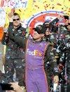 Denny Hamlin celebrates ...