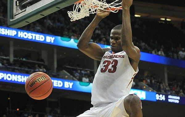 Arkansas center Moses Kingsley (33) dunks the ball during an NCAA Tournament game against Wofford on Thursday, March 19, 2015, at Veterans Memorial Arena in Jacksonville, Fla.