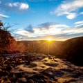The sun rises over the mountains in the Ozark National Forest near Ponca. Christians in Northwest Ar...