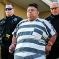 Mauricio Alejandro Torres, 45, is led out of Judge Brad Karren's court Tuesday in Bentonville. Torre...