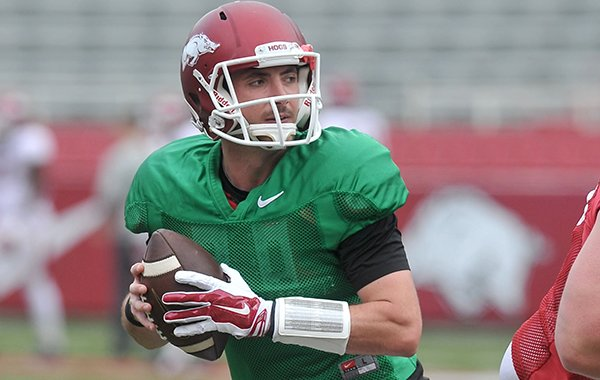 Arkansas quarterback Brandon Allen goes through drills Saturday, April 11, 2015, at Razorback Stadium in Fayetteville.