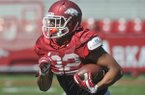 Arkansas running back Jonathan Williams carries the ball during practice Saturday, April 4, 2015, at Donald W. Reynolds Razorback Stadium in Fayetteville.