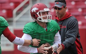 Arkansas quarterback Austin Allen works with offensive coordinator Dan Enos during practice Saturday, April 11, 2015, at Donald W. Reynolds Razorback Stadium in Fayetteville.