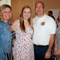 Kalie Hollis, Girls on the Run scholarship recipient (second from left), is joined by her parents Ki...