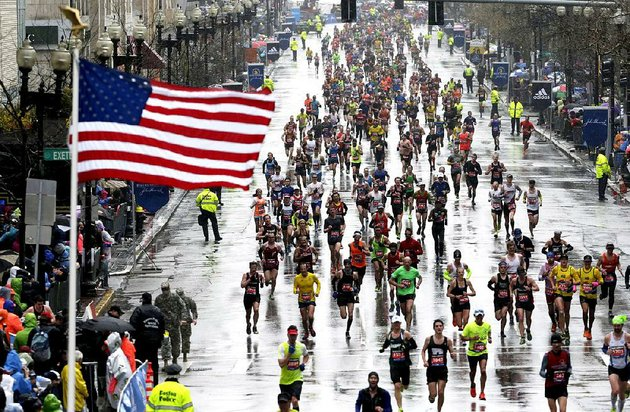 runners-approach-the-finish-line-in-the-rain-during-the-boston-marathon-monday-april-20-2015-in-boston-ap-photocharles-krupa