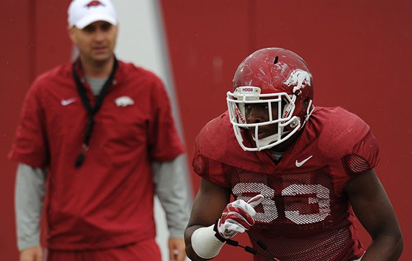 Jeremy Sprinkle of Arkansas works through a drill during practice Saturday, April 18, 2015, at the university's practice facility in Fayetteville.