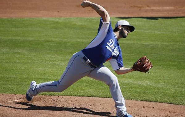 Los Angeles Dodgers' Mike Bolsinger pitches in the first inning of a spring training exhibition baseball game against the Cleveland Indians Saturday, March 7, 2015, in Goodyear, Ariz. (AP Photo/John Locher)