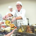 Megan Templeton, culinary arts student, serves burger samples Wednesday to visitors during a cook-of...