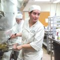 Mallorie Treece, culinary arts student, cooks eggs in the kitchen Wednesday during the cook-off in R...