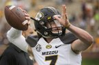Missouri quarterback Maty Mauk warms up before an NCAA college spring football game Saturday, April 18, 2015, in Columbia, Mo. (AP Photo/L.G. Patterson)