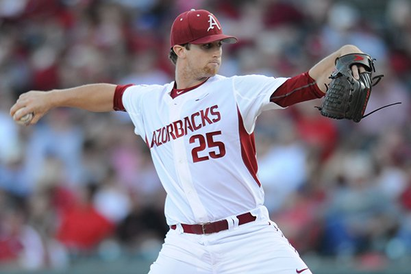 Dominic Taccolini of Arkansas delivers to the plate against Mississippi State during the fourth inning Saturday, April 25, 2015, at Baum Stadium in Fayetteville.
