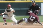 Mississippi State's Reid Humphreys makes it to second ahead of the tag by Arkansas' Michael Bernal Sunday, April 26, 2015 at Baum Stadium in Fayetteville. The Hogs lost 2-1.
