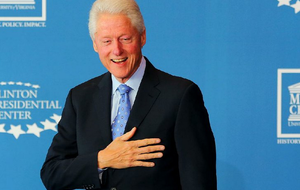 Former President Bill Clinton holds his hand to his heart at the Clinton Presidential Center in Little Rock in this Nov. 14, 2014 file photo.