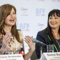 Wanda Young (right) with Walmart watches and listens Tuesday as actress Geena Davis, co-founder of t...