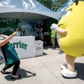 "Sonya Collingsworth of Bentonville tries to ""reel in"" an M&M candy mascot Wednesday at the Sponsor V..."