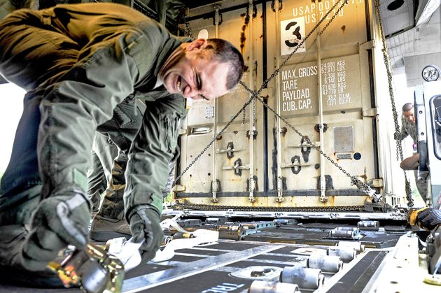 staff-sgt-nicholas-kaiser-a-41st-airlift-squadron-loadmaster-straps-down-cargo-in-preparation-for-a-mission-at-the-little-rock-air-force-base-on-april-19-the-cargo-was-used-in-support-of-a-green-flag-little-rock-exercise-at-fort-polk-la