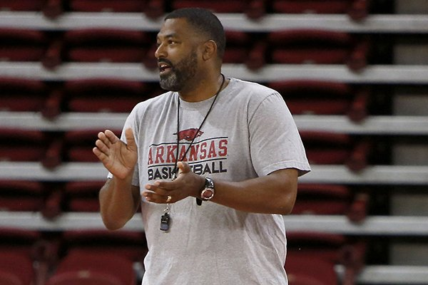 Arkansas student assistant coach Lee Mayberry watches practice Tuesday, Oct. 7, 2014, at Bud Walton Arena in Fayetteville. Mayberry will graduate from the University of Arkansas on Saturday, nearly 27 years after enrolling at the school.