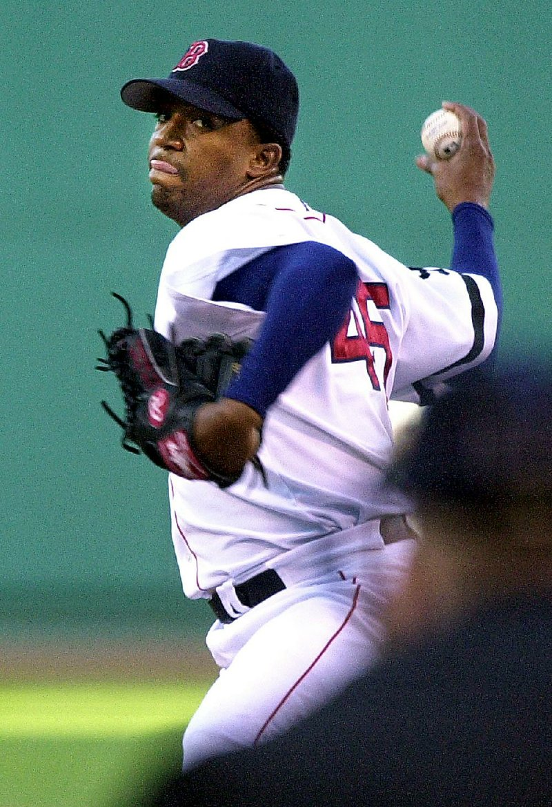 b9deb5b84 Boston Red Sox starting pitcher Pedro Martinez delivers against the Tampa  Bay Devil Rays in the first inning at Boston s Fenway Park
