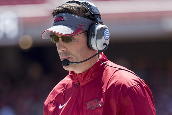 Arkansas offensive coordinator Dan Enos calls a play during the Razorbacks' spring NCAA college football game Saturday, April 25, 2015, in Fayetteville, Ark. (AP Photo/Gareth Patterson)