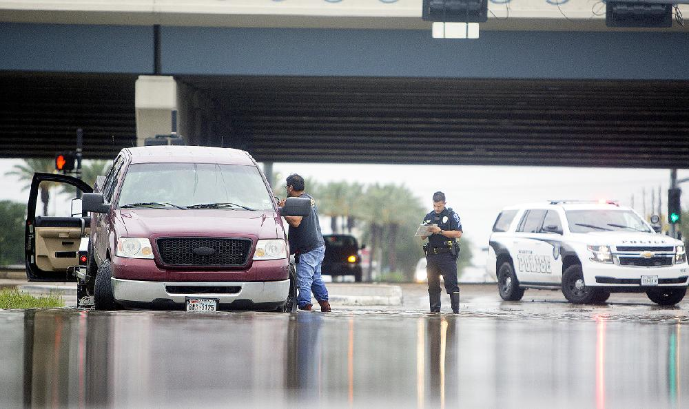 A Tow Truck Driver Works To Remove A Vehicle Stalled