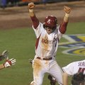Arkansas' Rick Nomura celebrates after scoring the game-winning run in the ninth inning of an SEC To...