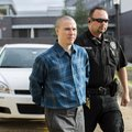Zachary Holly is escorted into the Benton County Courthouse in Bentonville on Tuesday for his trial ...