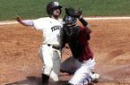 Texas A&M's Ryne Birk (2) slides safely into home plate under the tag of Alabama's Will Haynie (24) during the third inning of the Southeastern Conference college baseball tournament at the Hoover Met, Wednesday, May 20, 2015, in Hoover, Ala. (AP Photo/Butch Dill)