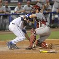 Arkansas catcher Alex Gosser tags out Florida's J.J. Schwarz on a double play to end the fourth inni...