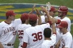 Alabama's Will Haynie, rear right, celebrates with teammates after hitting a home run against Missouri during the seventh inning of a game at the Southeastern Conference college baseball tournament at the Hoover Met, Thursday, May 21, 2015, in Hoover, Ala. (AP Photo/Butch Dill)