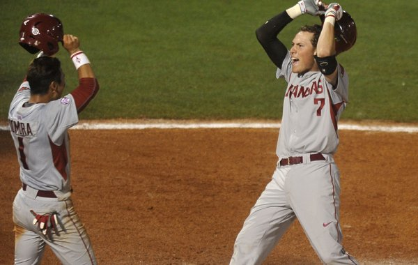 Arkansas' Bobby Wernes is greeted by teammate Rick Nomura after hitting a two-run home run in the ninth inning to take the lead over Florida Wednesday, May 20, 2015, at the SEC baseball tournament in Hoover, Alabama.