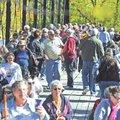 Pedestrians cross the War Eagle Bridge in 2012 to get to the War Eagle Mill Craft Show and the War E...