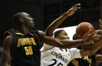 Kennesaw State center Willy Kouassi battles Cincinnati guard Kevin Johnson for a rebound on Friday, Nov. 29, 2013, at Fifth Third Arena in Cincinnati. (AP Photo/David Kohl)