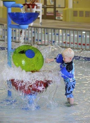 Bentonville community center holds grand opening nwadg for Bentonville pool
