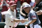 Arkansas coach Dave Van Horn, left, greets Missouri State coach Keith Guttin before a super regional game of the NCAA college baseball tournament, in Fayetteville, Ark., Sunday, June 7, 2015. (AP Photo/Danny Johnston)