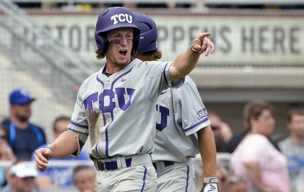 TCU's Cody Jones celebrates after scoring on a single by Connor Wanhanen in the fourth inning of an NCAA College World Series baseball game against LSU at TD Ameritrade Park in Omaha, Neb., Sunday, June 14, 2015. (AP Photo/Ted Kirk)