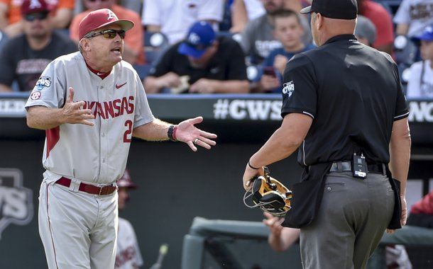 Arkansas coach Dave Van Horn, left, argues with home plate umpire Patrick Riley after Arkansas batter Clark Eagan was hit by a pitch in the second inning of an NCAA College World Series baseball tournament elimination game against Miami at TD Ameritrade Park in Omaha, Neb., Monday, June 15, 2015. (AP Photo/Mike Theiler)
