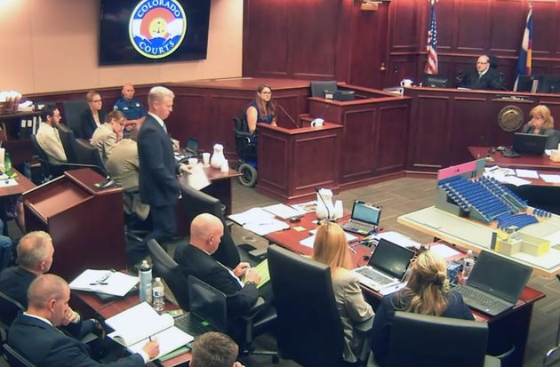 in-this-image-taken-from-video-ashley-moser-center-top-who-lost-her-6-year-old-daughter-veronica-was-paralyzed-and-suffered-a-miscarriage-in-the-2012-colorado-movie-theater-mass-shooting-testifies-during-the-trial-of-theater-shooter-james-holmes-pictured-at-top-left-in-centennial-colo-friday-june-19-2015-with-mosers-testimony-the-prosecution-rested-its-case-led-by-district-attorney-george-brauchler-pictured-fifth-from-left-standing
